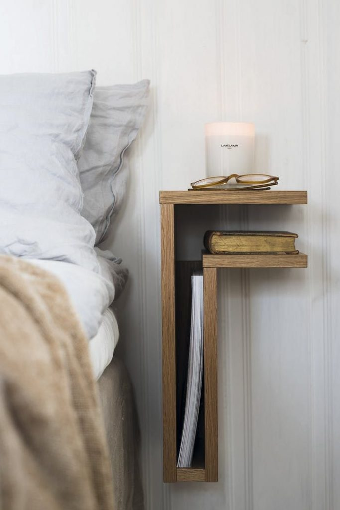 A bedside table that is formed as the letter F. Very decorative way to place you...