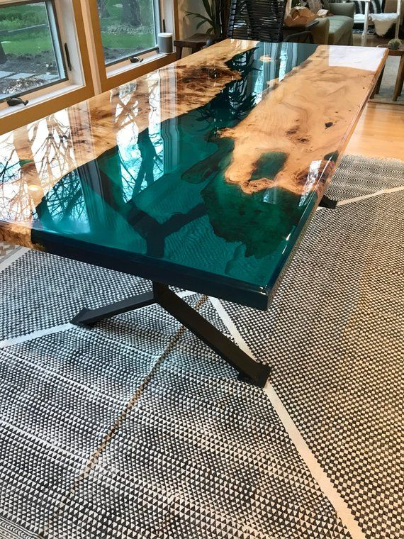 This beautiful resin table is sold, but it is a good example of the t ...
