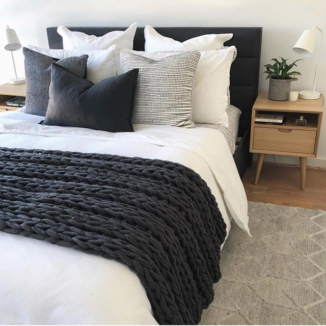 Simple, clean bedroom decor, white comforter, black and anthracite gray pillows and ...
