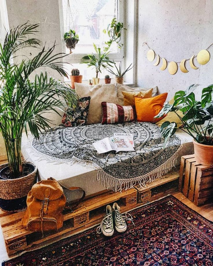 Sharp beach boho family room with a moon cycle decoration over the classic white...