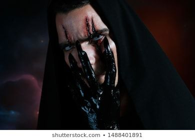 #An #evil #demon  An evil demon hides his face behind his black hand and looking...
